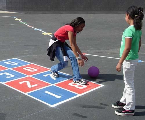 Grade school girls playing ball.