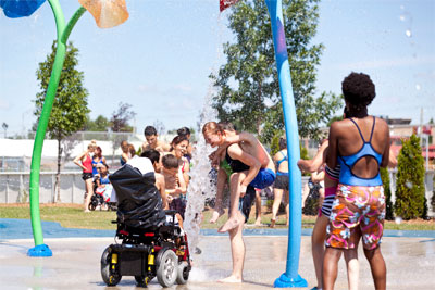 Children of all abilities enjoying a splash pad.