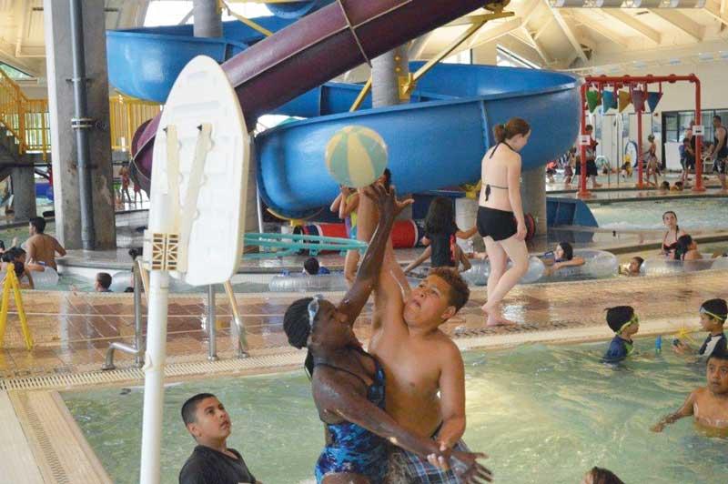 Kids playing water basketball