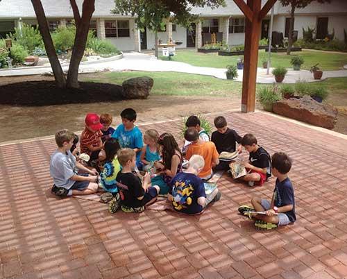 Children sitting on a patio