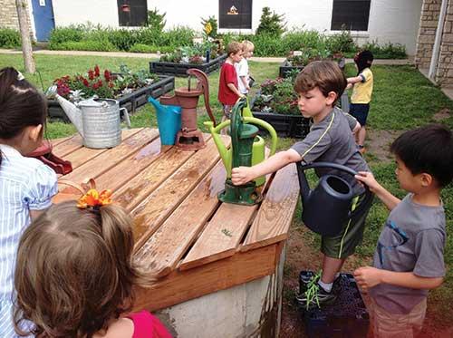 Children filling water buckets