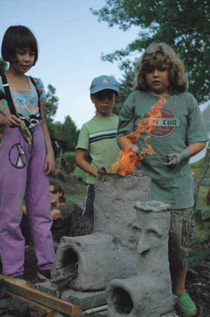 Children cooking over a fire
