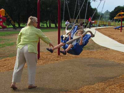 Grandmother with child in swing