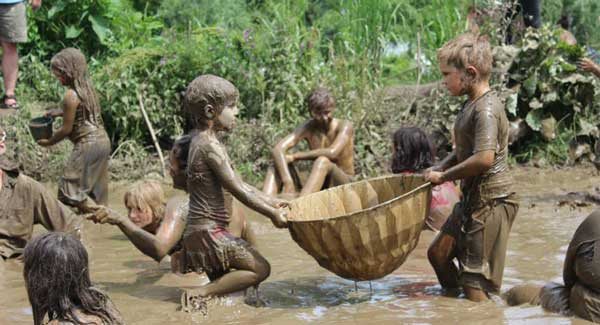 Children playing in the mud