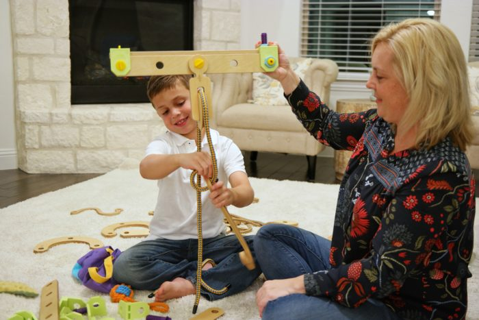 Mother and son play with the Rig Junior