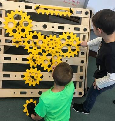 Children play with the Simple Machines add-on.