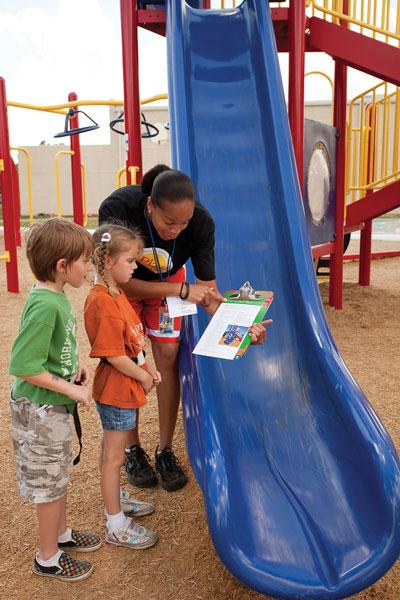 Children being instructed on playground