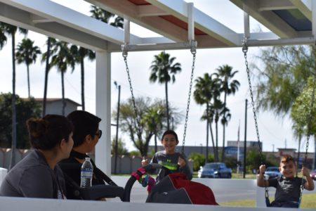 Kids swing at bus stop