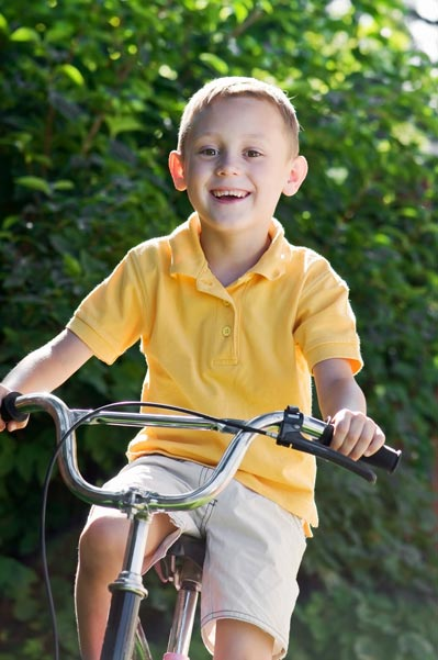 Young boy biking to school