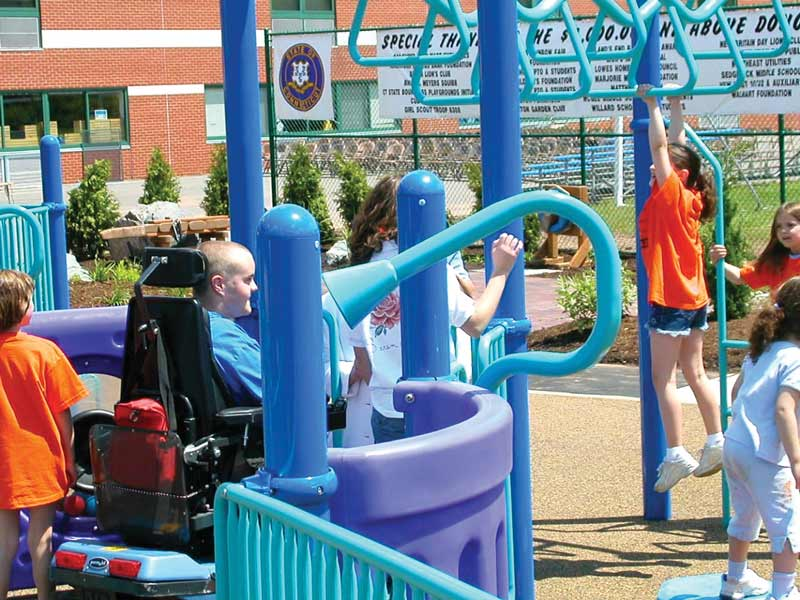 Kids on inclusive playground equipment