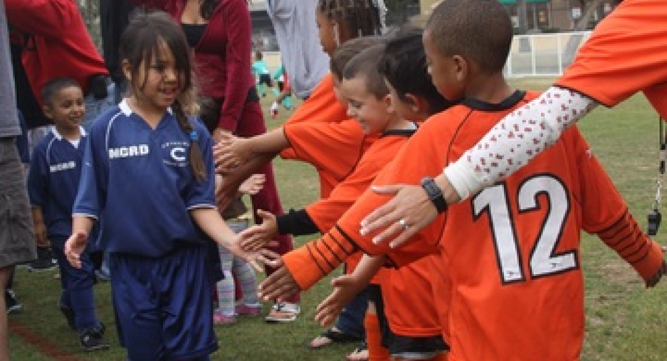 Kids shaking hands after a game