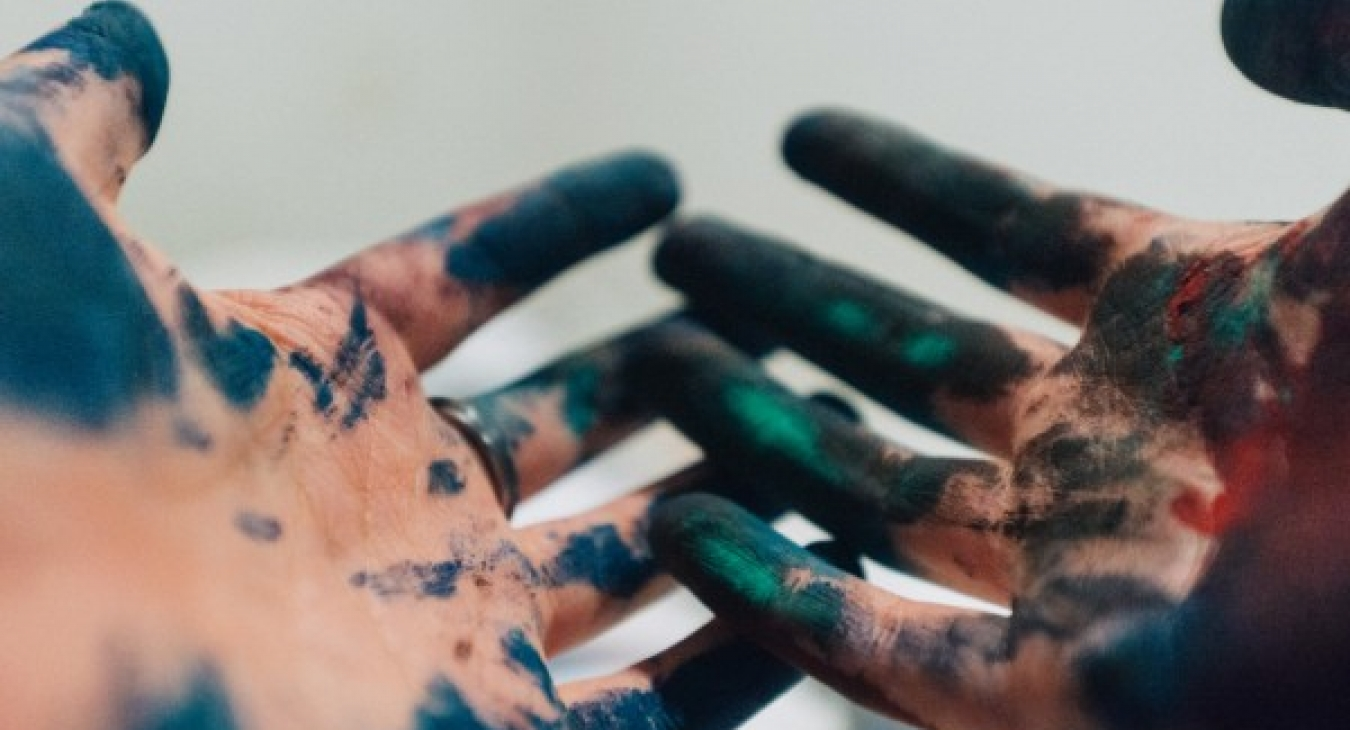 A child's paint-covered hands