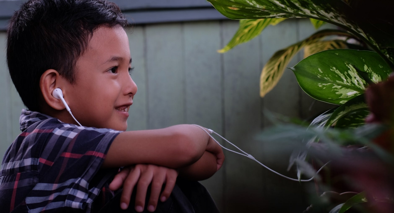 Boy wearing earphones.
