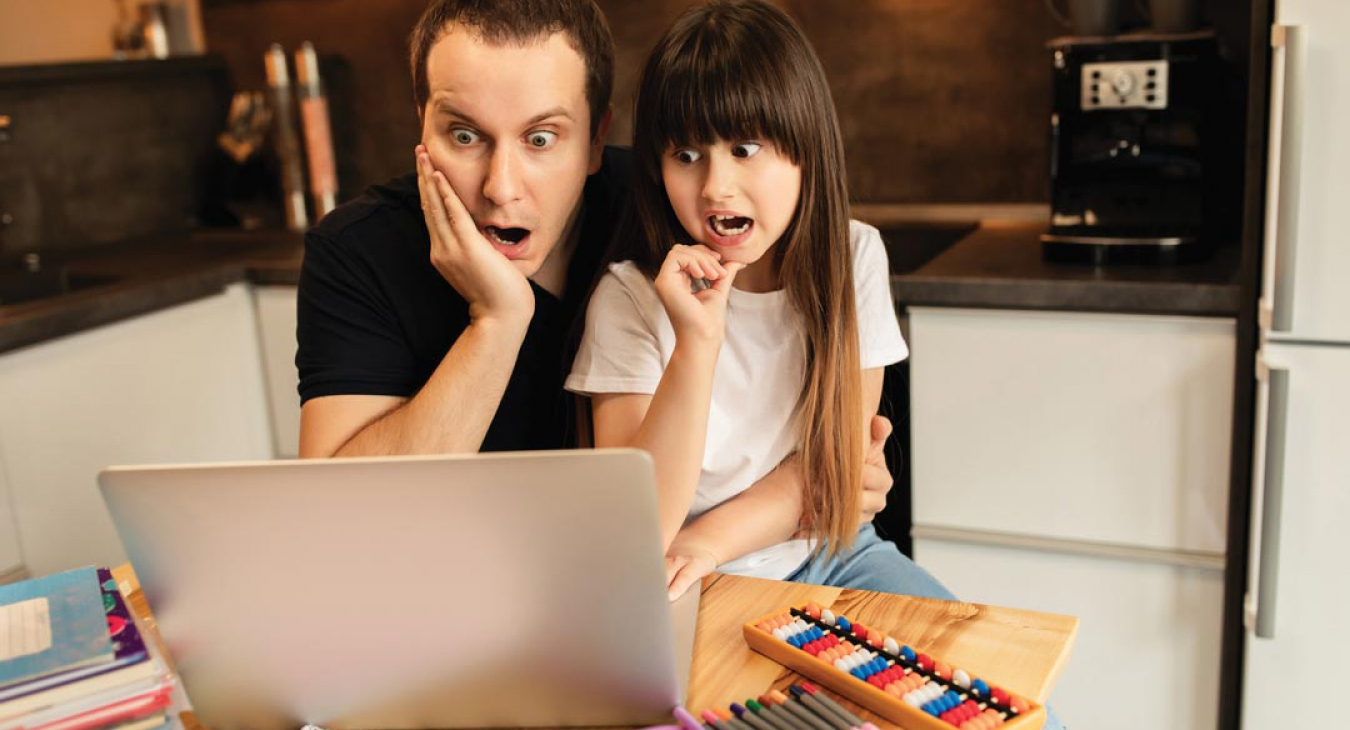Father and daughter overwhelmed by homework