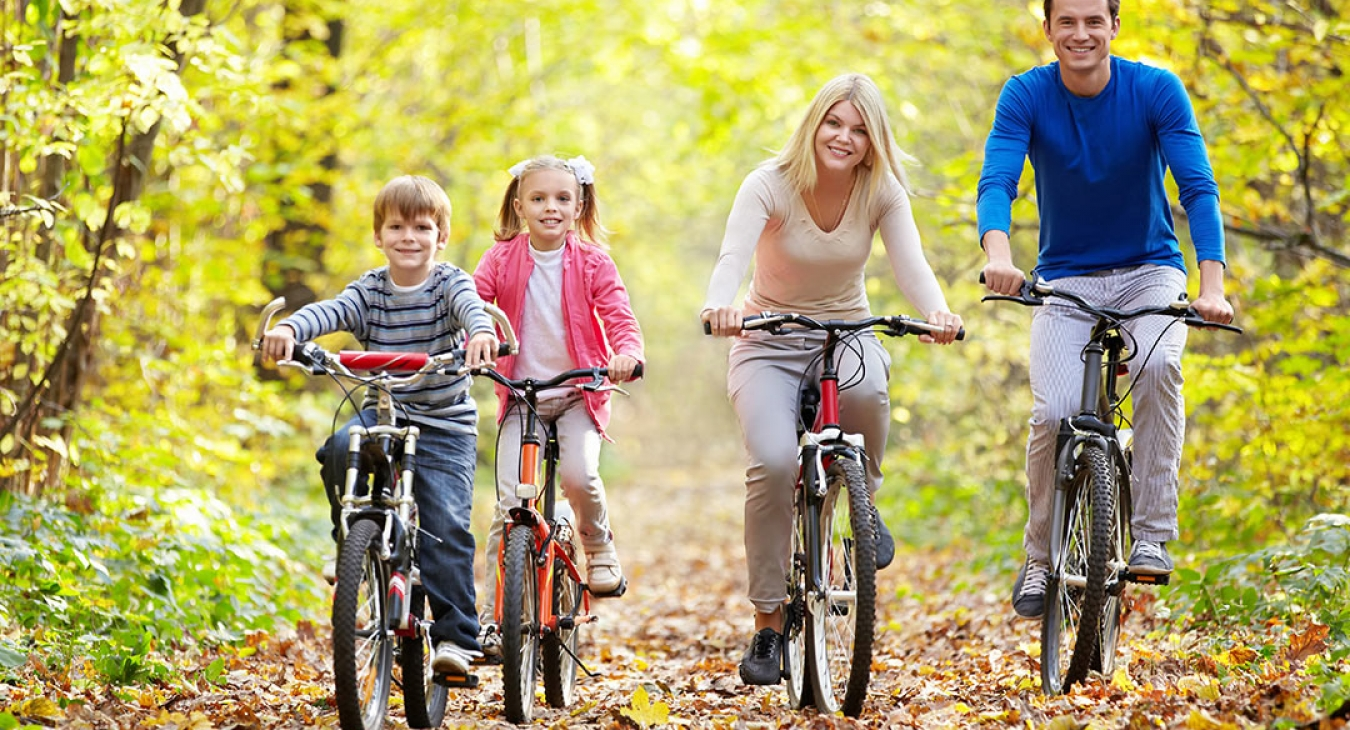 happy family biking on an autumn day