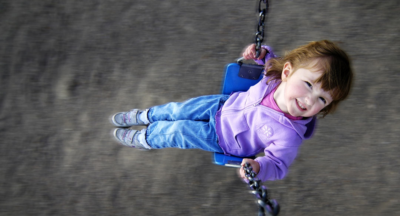 girl swinging on a swing set