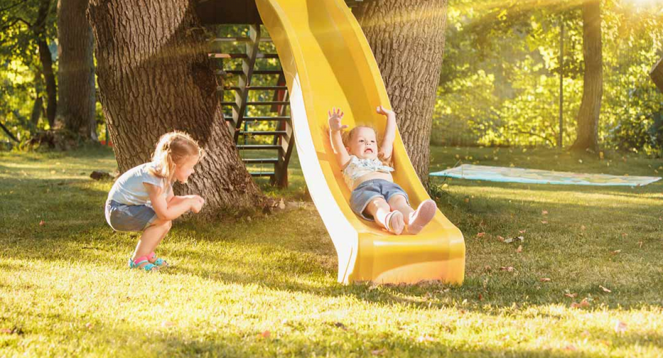 Child sliding on a backyard slide