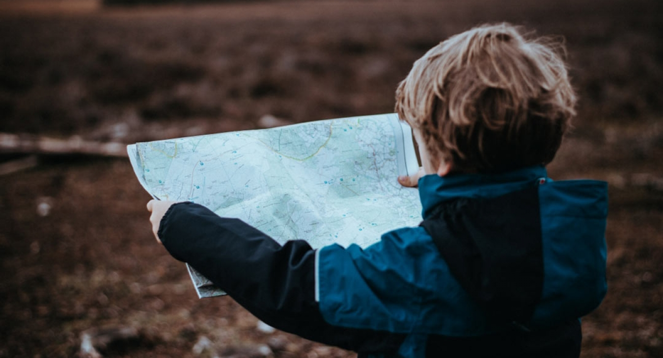boy looking at a map