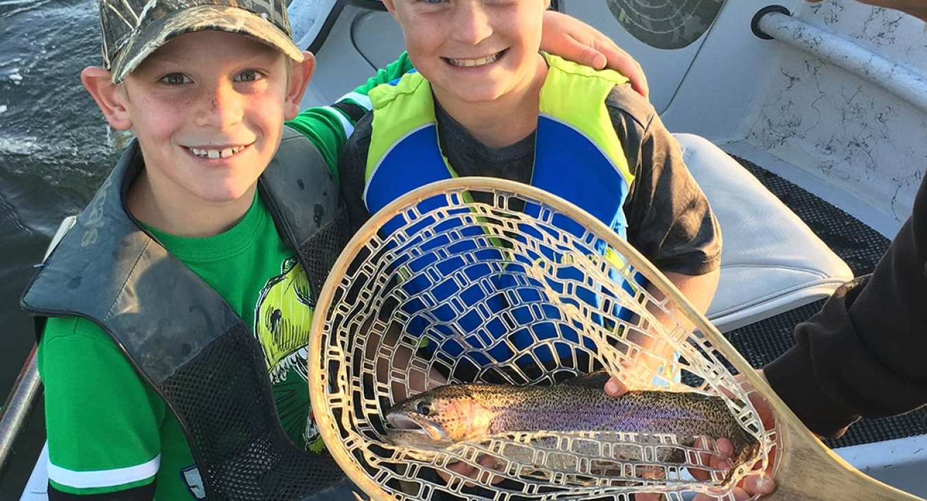 2 boys with a rainbow trout