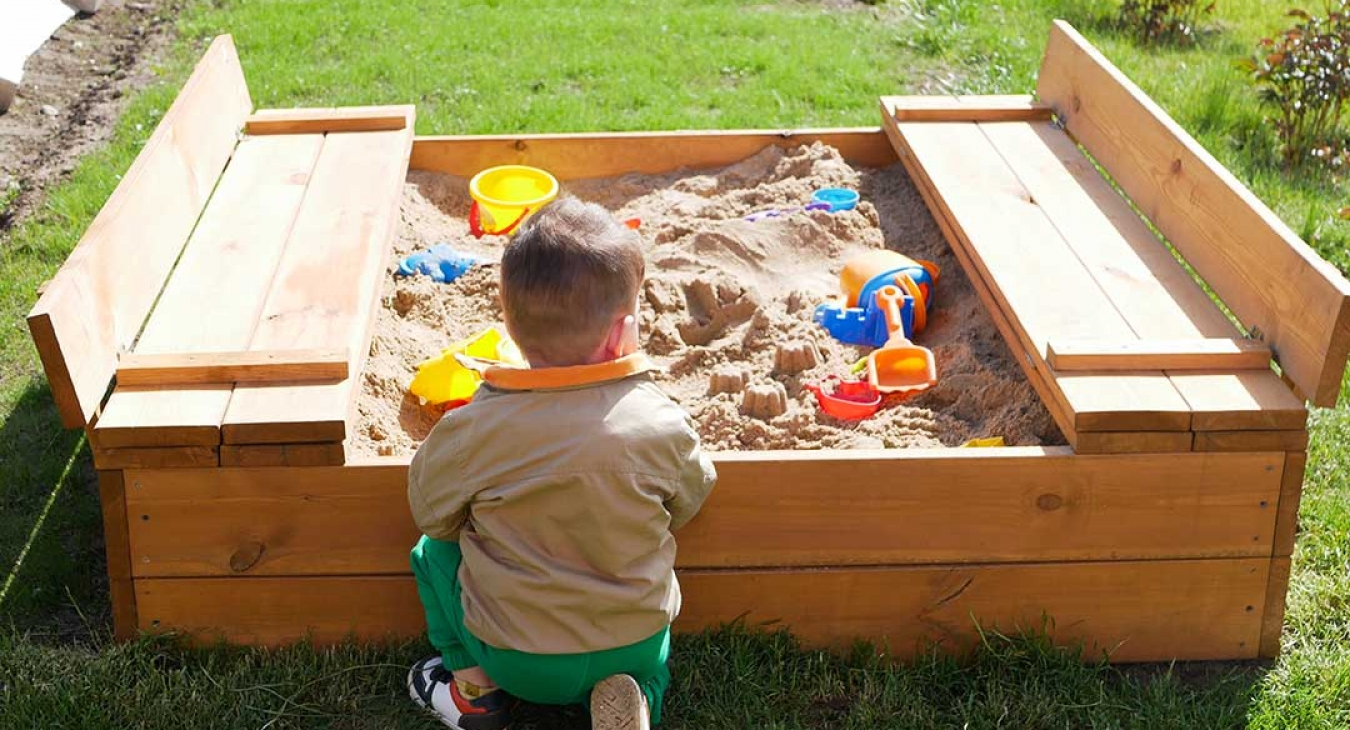 child spends time playing in sandbox