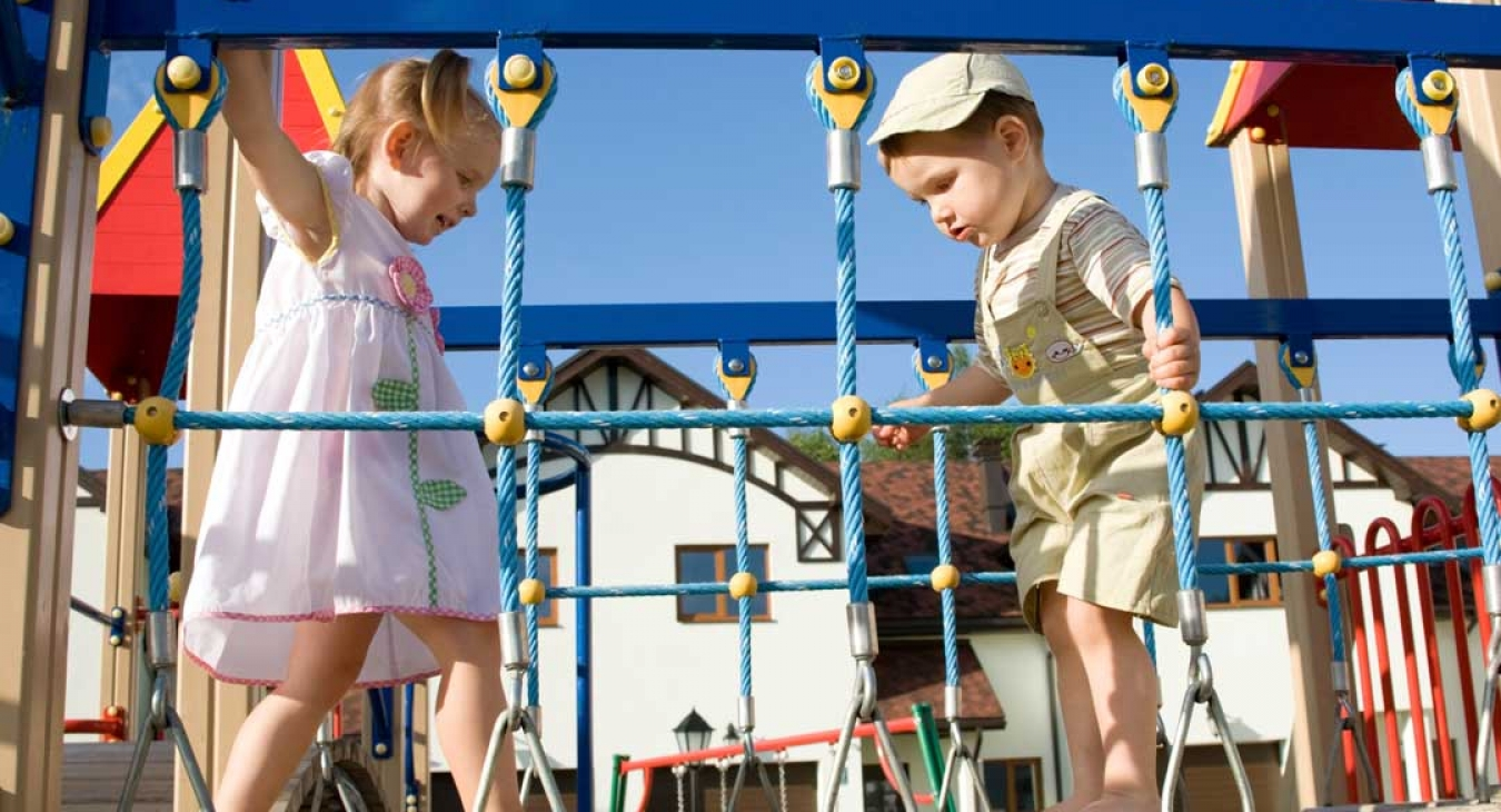 Children playing safe on a playground
