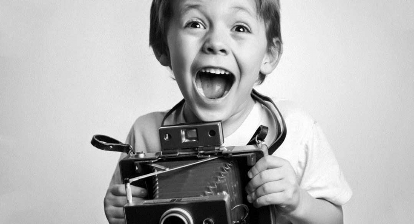 Child with camera taking photos