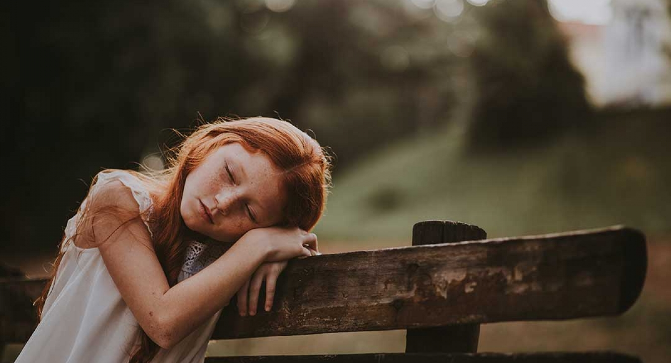 Young redhead girl feeling depressed