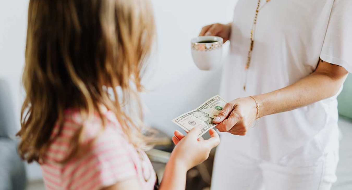 grandmother giving granddaughter money
