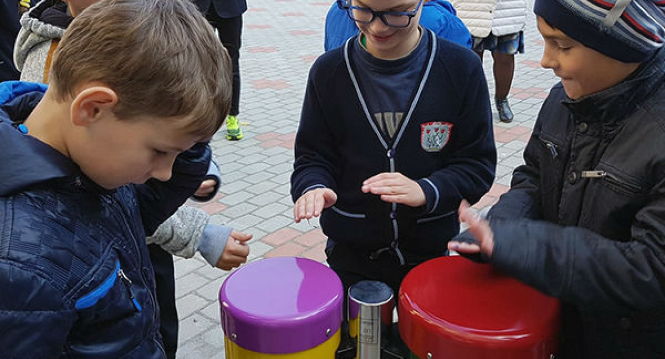 Boys playing conga drums
