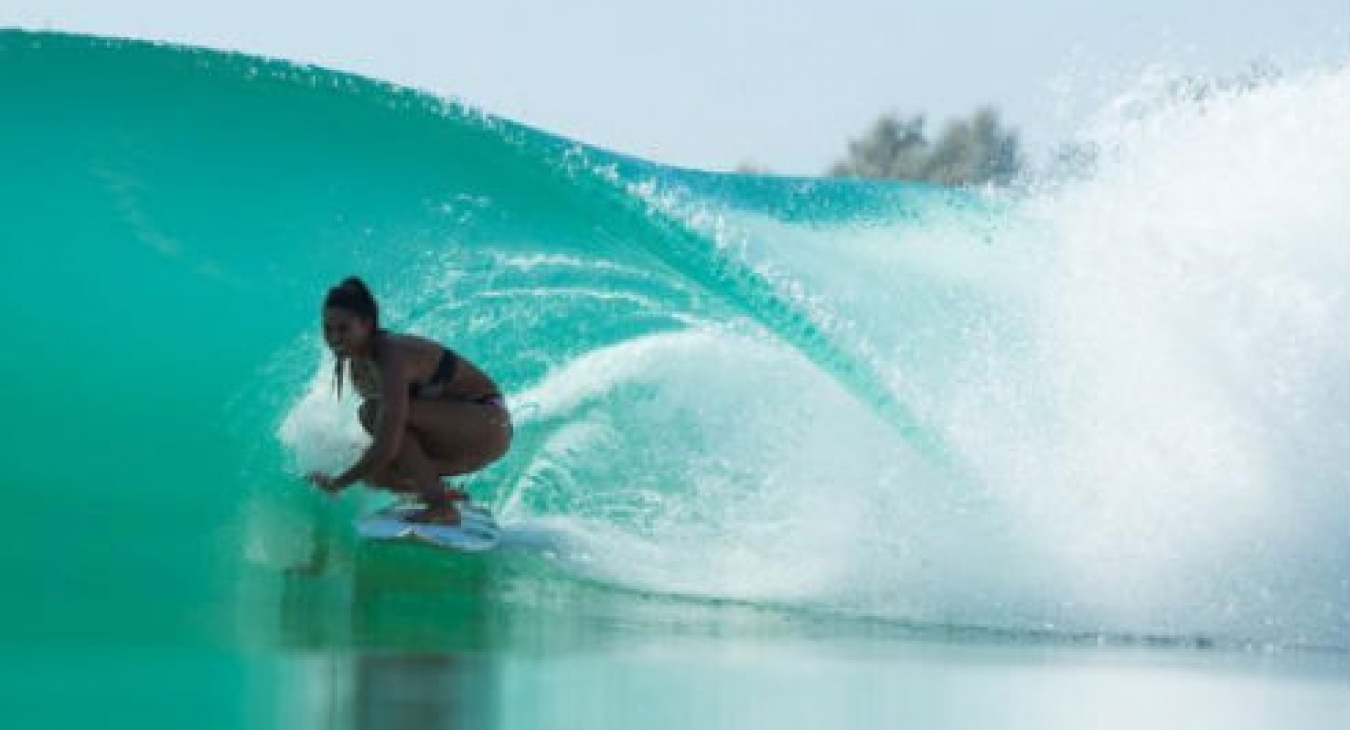 Woman surfing a Kelly Slater Wave