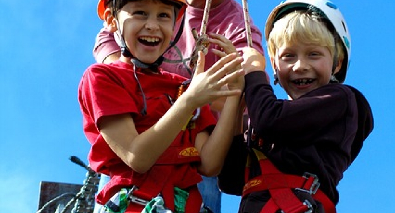 Kids excited to ride a zip line.