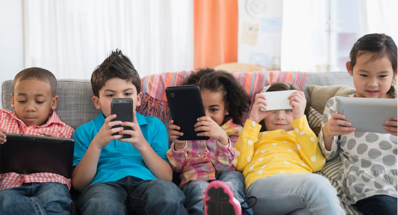 Children using smartphones and tablets.