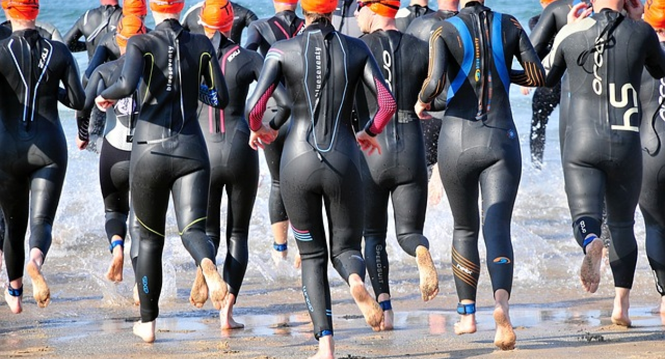 Swimmers at the start of a triathlon