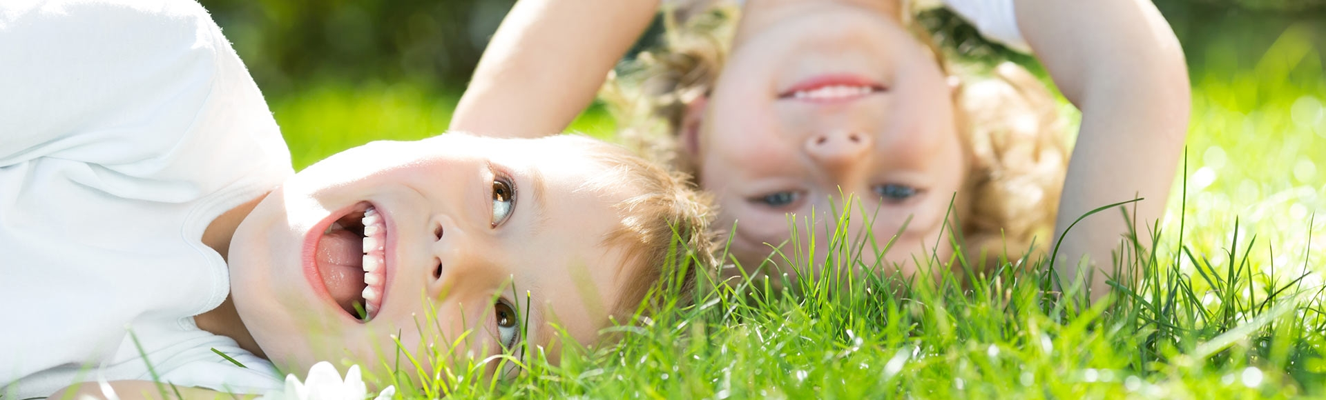 young children playing in grass