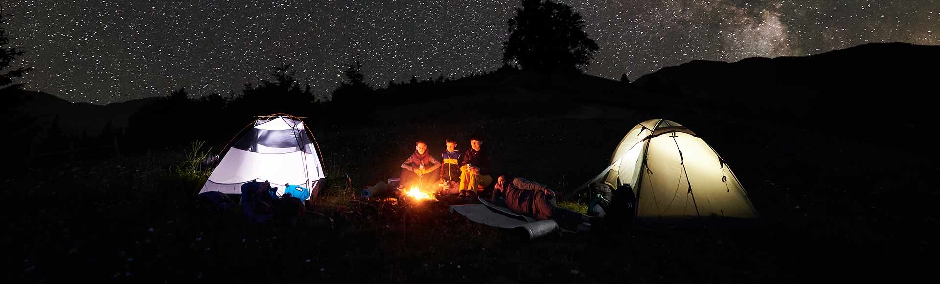 Family by the fire on a starry night