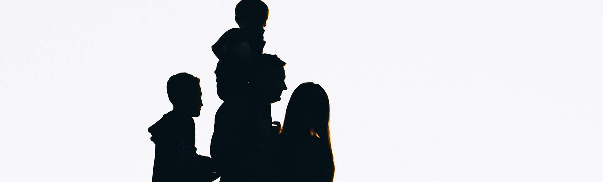 silhouette of a family in the sunset